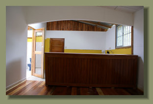 the view of the kitchen of this small ahouse in puerto jimenez, osa peninsula real estate for sale quickly